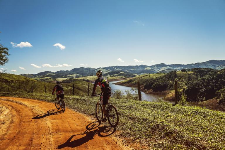 Two adventure travellers cycling in the mountains