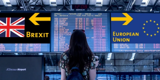 Women at airport looking at sign- Brexit and European Union